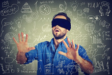 Blindfolded Young Business Man...