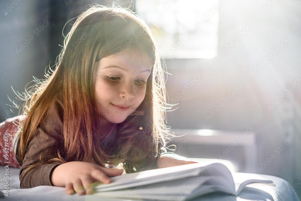 Fotografía Cute Girl Reading a Book at Home