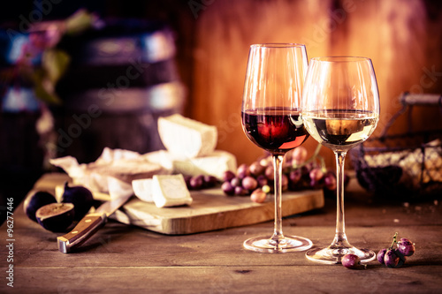 Poster Wine Cheese platter with wine in front of fire