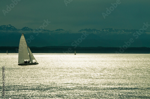 Staande foto Zeilen Sailing. Sailboats on Moonlit Water. Mountains in background Copy Space.