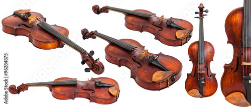Carta da parati set of old violins isolated on white