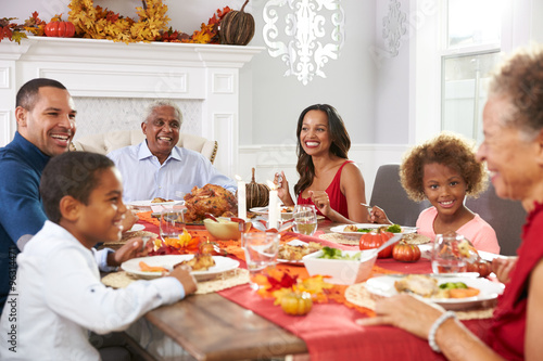 Family With Grandparents Enjoying Thanksgiving Meal At Table Buy