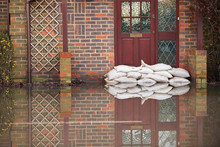 Sandbags Outside Front Door Of...