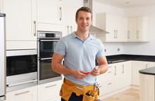 Workman Installing Luxury Fitted Kitchen