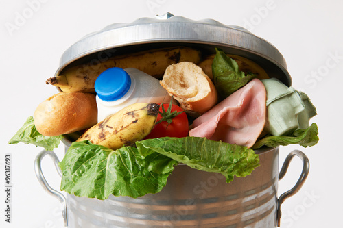 Fotografija  Fresh Food In Garbage Can To Illustrate Waste