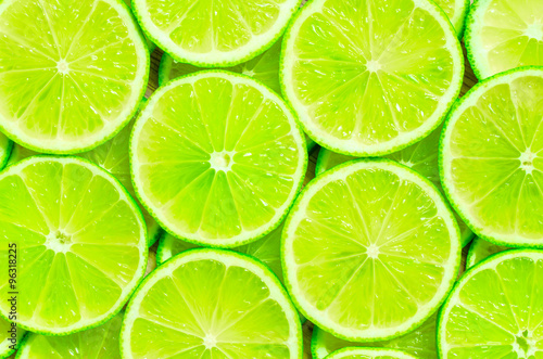 Vászonkép Lime slices background
