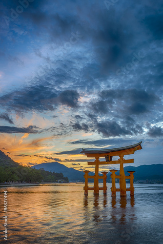 Sunset at the famous floating torii gate of the Itsukushima Shri