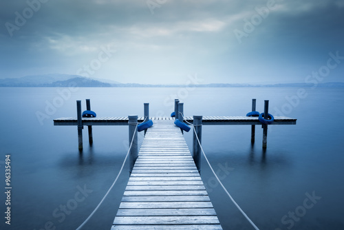 Fototapety, obrazy: Lake Zug. Wooden pier on the lake. Fog. Long exposure.