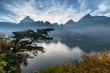 Mountain landscape. Magnificent sky over mountain range and lake.