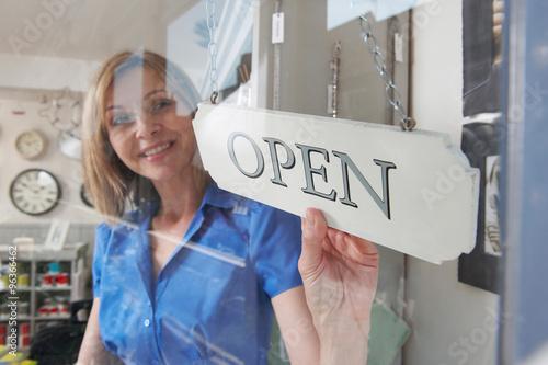 Store Owner Turning Open Sign In Shop Doorway Fototapet