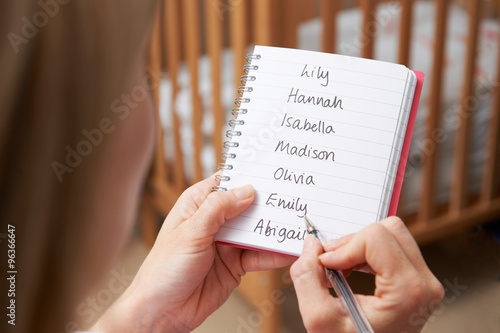 Fotografía  Woman Writing Possible Names For Baby Girl In Nursery