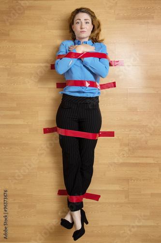 Fotografie, Obraz  Woman stuck to the floor