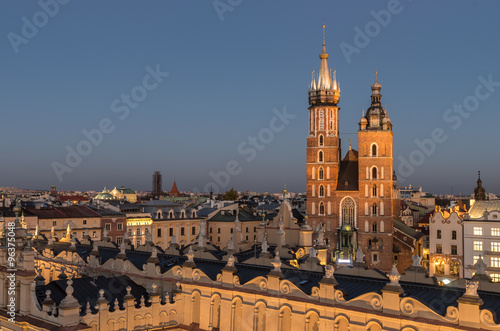 Krakow, Poland, Virgin Mary church on the Main Market Square seen over Sukiennice (Cloth Hall) from the Town Hall tower in the night