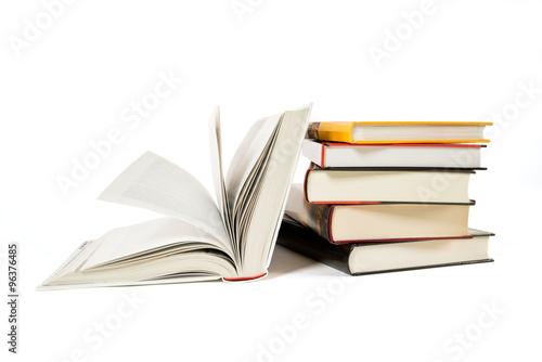 Fotografie, Obraz  Pile of old books isolated on white
