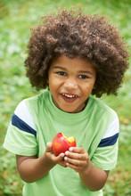 Little Boy Eating Nectarine Outdoors