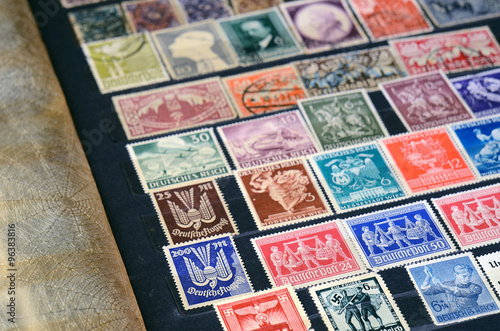 Fotografering  Album with old postage stamps