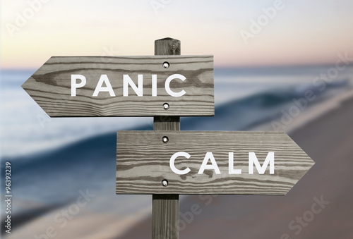 Cuadros en Lienzo Calm vs Panic signs with blurred beach background