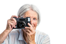 Senior Woman Shooting With A Retro Camera Over White Background