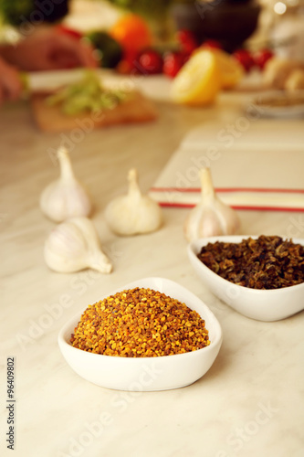 Photo Stands Herbs 2 Variety of spices in ceramic containers on the kitchen table