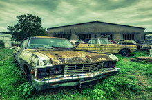 Wrecked American Cars At An Oldtimer Scrapyard