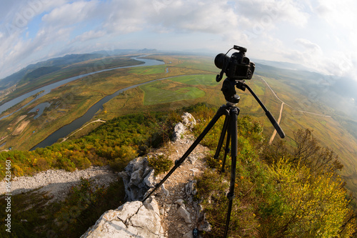Fotografie, Obraz  Camera is on a tripod on top of the mountain, fisheye lens