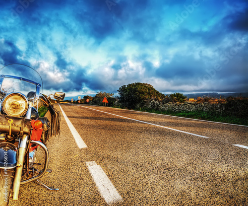 Fotobehang Fiets classic motorcycle on the edge of the road