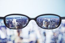Clear Vision Concept With Eyeglasses And Night Megapolis City Ba