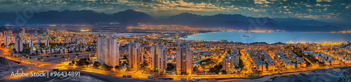 Foto op Plexiglas Barcelona Nocturnal panoramic view on the Red Sea from the red hills of Eilat. Eilat is a famous resort and recreation city in Israel