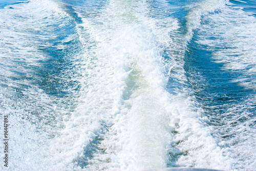 Fotografie, Obraz  Boat wake from a high powered boat motor pushing a boat at high speed