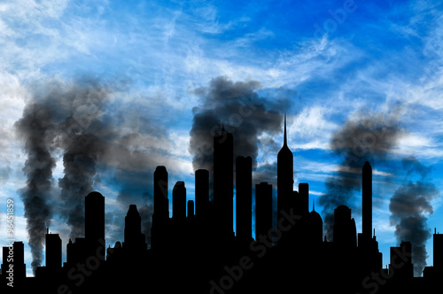 Fotografía  Silhouette of city in smoke against cloudy sky