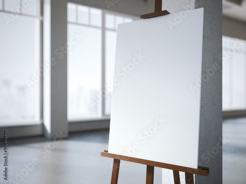 Photo  Wooden easel with a blank white canvas in modern interior.