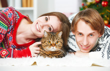 Happy Family Couple And A Cat ...