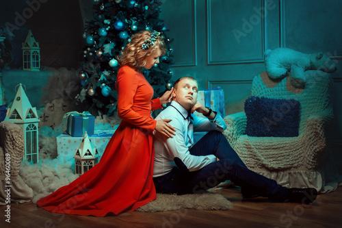 Printed kitchen splashbacks Fairytale World Couple sitting on the floor under Christmas tree.