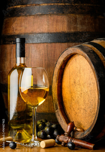 Fotografie, Obraz  white wine on wooden barrel background