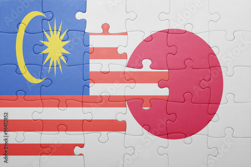 puzzle with the national flag of japan and malaysia Poster