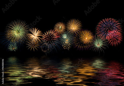 Festive fireworks display with reflections, copy space Poster