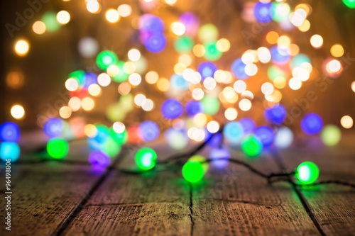 christmas new year party background colorful lights on wood