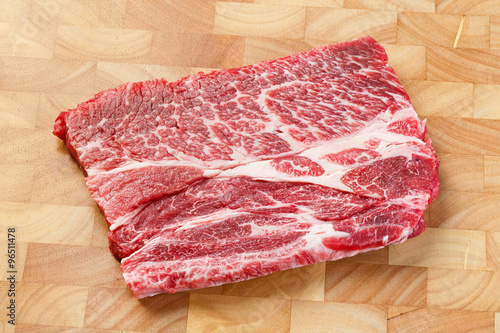 Beef chuck steak on chopping board Poster