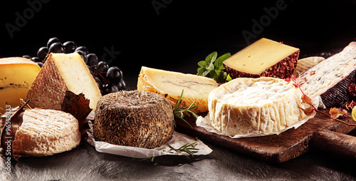 Fototapeta Variety of Cheeses on Table with Dark Background obraz