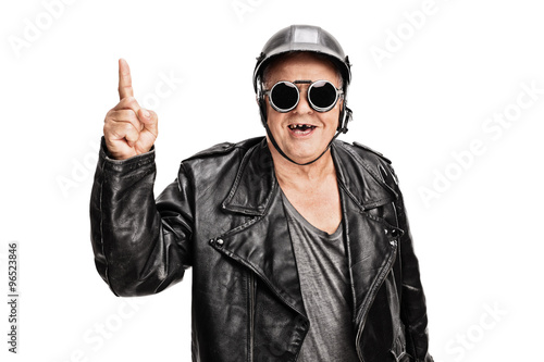 Cheerful senior biker pointing up Poster