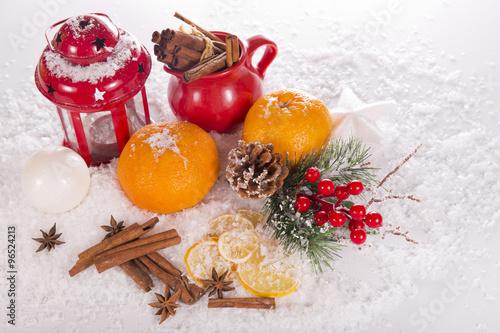 Fototapeta Christmas composition of the candlestick, tangerines, cinnamon, anise and dried lemons obraz na płótnie