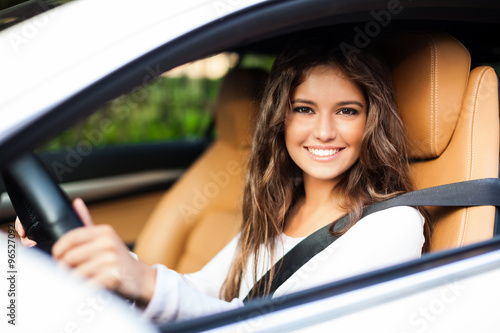 Fototapeta Woman driving her car