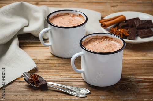 Poster Chocolade Hot chocolate on the rustic wooden table