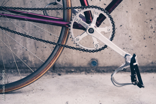 Fotobehang Fiets Road bicycle and concrete wall, urban scene vintage style