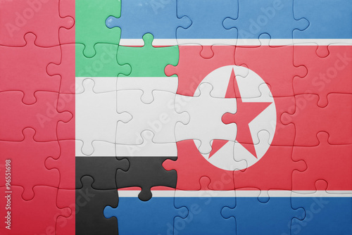 Photo  puzzle with the national flag of north korea and united arab emirates