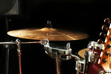 Fototapeta na wymiar Musical instruments on a stage on dark background