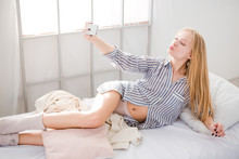 Young Blonde Woman Making Self...