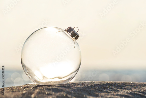 Fotografia, Obraz  Christmas-tree decoration glass ball at ocean beach sunset time