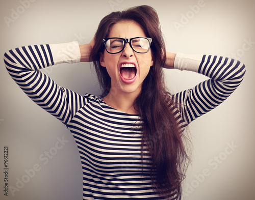 Fotografie, Tablou  Angry young business woman in glasses strong screaming with wild