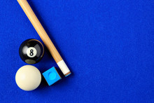 Billiard Balls, Cue And Chalk In A Blue Pool Table.